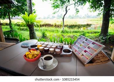 Ubud, Bali / Indonesia - December 26 2017: A tasting set of traditional luwak coffee and teas on a coffee farm