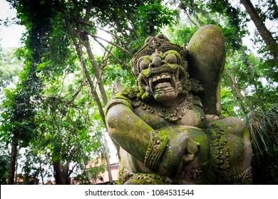Ubud, Bali / Indonesia - December 29 2017: A moss covered statue of the god Barong in the Monkey Forest of Ubud