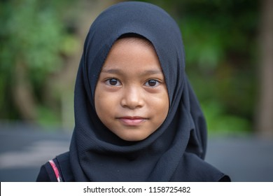 UBUD, BALI, INDONESIA - JANUARY 2, 2018 : Unidentified portrait of a little indonesian muslim girl at the streets in Ubud, island Bali, Indonesia, close up