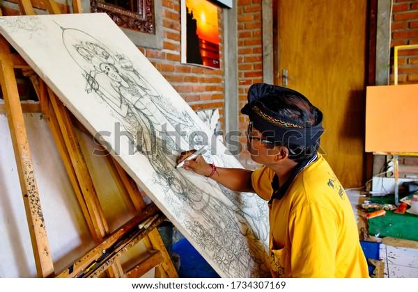 Ubud, Bali, Indonesia - January, 2020: Artist drawing in artistic painting workshop in Ubud, Bali Island.