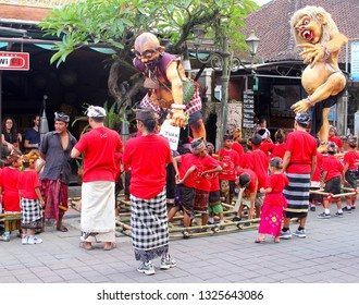 UBUD, BALI, INDONESIA - March 17, 2018. Group of Balinese adults and children in traditional  costumes celebrate Nyepi silent day and New Years Eve with giant scary puppets to chase away the demons.
