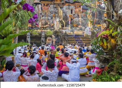 UBUD, BALI, INDONESIA - MARCH 24, 2018 : Unidentified Indonesian people praying at holy temple during the religious ceremony in Ubud, island Bali, Indonesia