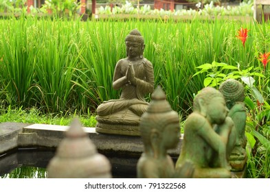 Ubud, Bali, Indonesia. October 24, 2017. Buddha statues near a pond among rice paddies. Ubud, autumn of 2017