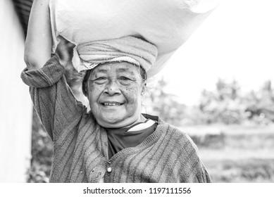 Ubud, BALI - JULY 17, 2018: Portrait of traditional rice field worker in Bali