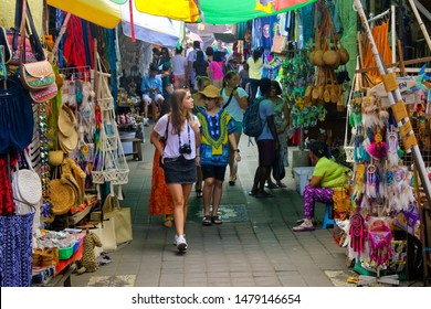 UBUD, BALI - JULY 2019:Tourists shopping at Ubud Market in Bali Island Indonesia. Ubud located in the uplands of Bali, Indonesia, is known as a culture centre for traditional food and crafts.