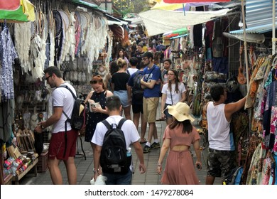 UBUD, BALI - JULY 25 2019:Tourists shopping at Ubud Market in Bali Island Indonesia. Ubud located in the uplands of Bali, Indonesia, is known as a culture centre for traditional food, art and crafts.