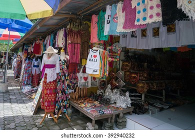 UBUD, BALI - MARCH 14, 2016: Souvenir items from art, handicraft to shirts are for sale on at the souvenir market in Pura Tirta Empul (temple), Bali.