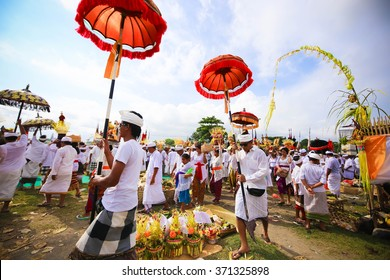 "UBUD, BALI - MARCH 28: Melasti Ritual is performed before Nyepi - a Balinese ""Day of Silence"" that is commemorated every year  on March 28, 2014 in Ubud, Bali, Indonesia."