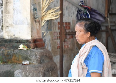 UBUD, INDONESIA - AUGUST 18, 2016 - Local Bali island people selling goods and buying at town market