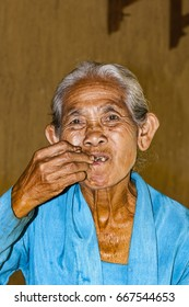Ubud, Indonesia - July 28, 2013. An unidentified Balinese rice very old farmer poses during a morning's work near Ubud,