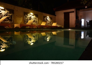 UBUD, INDONESIA - MARCH 16: low key swimming pool view at night on March 16, 2017 in Ubud, Indonesia. Ubud is one of the most popular tourist destinations on Indonesia's Bali.