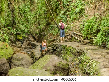 UBUD, INDONESIA - MARCH 17: tourists in the Sacred Monkey Forest Sanctuary on March 17, 2017 in Ubud, Indonesia. Ubud is one of the most popular tourist destinations on Indonesia's Bali.