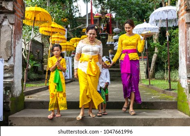 UBUD, INDONESIA - MARCH 2: Balinese family in traditional clothes during the celebration before Nyepi (Balinese Day of Silence) on March 2, 2016 in Ubud, Indonesia.