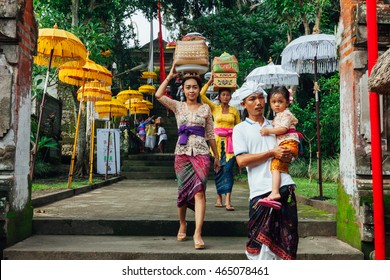 UBUD, INDONESIA - MARCH 2: Family walks down the stairs during the celebration before Nyepi (Balinese Day of Silence) on March 2, 2016 in Ubud, Indonesia.