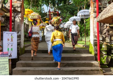 UBUD, INDONESIA - MARCH 2: Women walks up the stairs during the celebration before Nyepi (Balinese Day of Silence) on March 2, 2016 in Ubud, Indonesia.