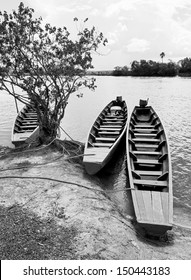 Ucaima port and boats on Carrao river near lagoon of Canaima national park - Venezuela, Latin America (black and white)