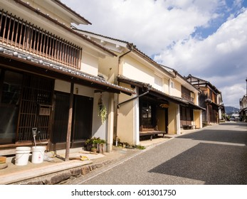 Uchiko, Japan - March 03, 2013: Sun shining over Edo period traditional merchant houses in historic Uchiko town