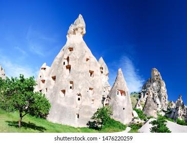 Uchisar castle in Cappadocia, Turkey. Cave houses in cones sand hills, Anatolia.