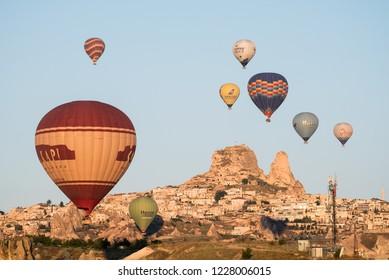 Uchisar, Kapadokya / Turkey - 21 June 2017: Hot air balloons and Uchisar castle in Kapadokya
