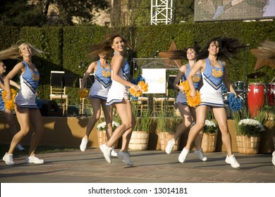 UCLA Day, Westwood, CA May 17th, 2008:  The UCLA Bruins cheer squad riles up the alumni crowd, at the first annual UCLA Day.