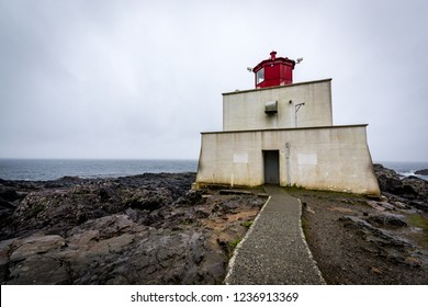 Ucluelet, British Columbia, Canada September 20, 2018 - Amphitrite Point Lighthouse is located off Barkley Sound & near the town of Ucluelet. It is often foggy & the foghorn can be heard frequently.