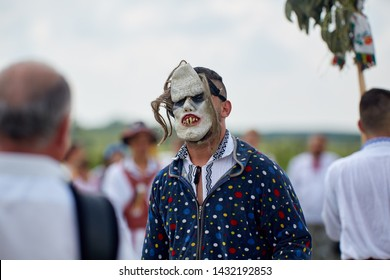 Uda, Romania, 20-06-2019: The folklore vocal and dance ensemble Calusarii Optasi performing at a fair outdoor