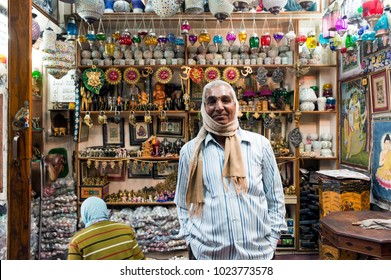 Udaipur city, Rajasthan, India – Feb 11  ,2017: Souvenir seller standing in front of the souvenir shelf, at the souvenir shop on the city palace road.