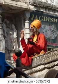 UDAIPUR, INDIA - DEC 2 -Hindu Sadhu gives blessings outside a temple on Dec 2, 2009 in Udaipur, India