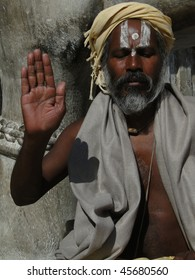 UDAIPUR, INDIA - DECEMBER 2 : Hindu Sadhu (a yogi) gives blessings outside a temple on December 2, 2009 in Udaipur, India