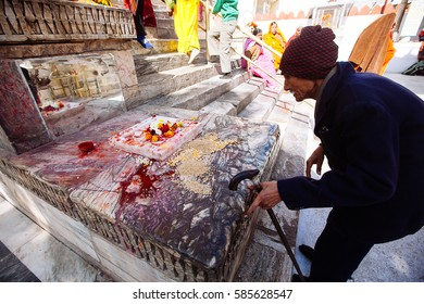 UDAIPUR, INDIA - JANUARY 12: Unidentified people near Jagdish temple on January 12, 2017 in Udaipur, India. Jagdish temple is a major monument and big tourist attraction in Udaipur.