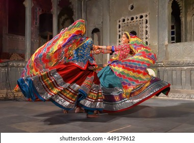 UDAIPUR, INDIA - JANUARY 29, 2014: An unidentified young indian women in national costumes perform dance at a traditional theater exposing local Rajasthan culture in Udaipur, India
