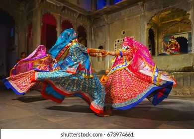 Udaipur, India  - January 29, 2014: Young indian women in national costumes dance at the open festival of traditional Rajasthan culture