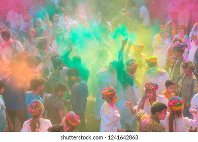 UDAIPUR, INDIA - MARCH 02, 2018: People covered in paint on Holi festival - People celebrated Holi Festival of Colors. Holi, marks the arrival of spring, being one of the biggest festivals