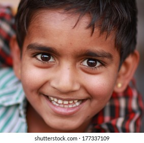 UDAIPUR, INDIA � MARCH 5: An unidentified boy at the gate of the City Palace on the east bank of Lake Pichola in Udaipur, Rajasthan, Western India on MARCH 5, 2012.
