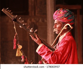 UDAIPUR, INDIA � MARCH 5: An unidentified Rajasthan performer playing sitar at a traditional theatre exposing local culture to boutique tourists in Udaipur, Rajasthan, Western India on MARCH 5, 2012.