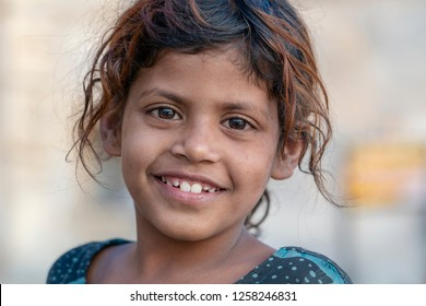 UDAIPUR, INDIA - NOVEMBER 19, 2018 : Indian young girl on street market in Udaipur, Rajasthan, India, close up portrait