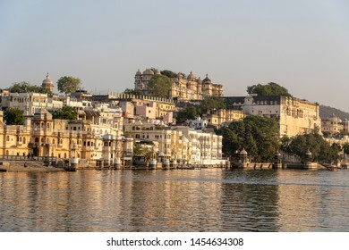 UDAIPUR, INDIA - NOVEMBER 19, 2018 : View on architecture and lake water in Udaipur, Rajasthan, India