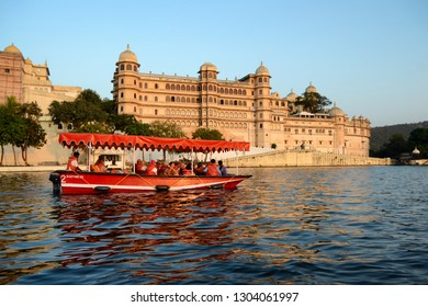 UDAIPUR, INDIA - November 4, 2015: Tourist boat on Lake Pichola with the old city in the background.