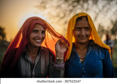 UDAIPUR - MARCH 25 : women posing in the field on March 25 , 2014 in Udaipur,India