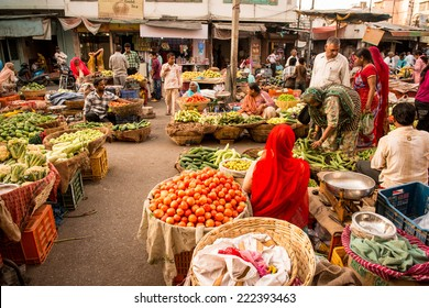 UDAIPUR, RAJASTAN- INDIA :MAY 27 2013 - Unidentified people selling vegetables on a street market on May 27, 2013 in Udaipur, India.