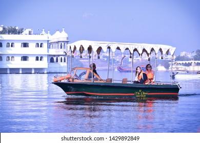 Udaipur, Rajasthan / India; 21 June 2019: Boat ride on lake pichola, Udaipur, Rajasthan, India. Lake pichola is the famous lake of udaipur.