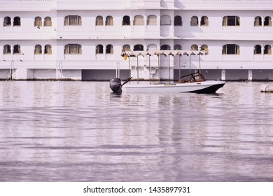 Udaipur, Rajasthan, India - 28 June 2019: Distant view of Taj Lake Palace shot at evening, Udaipur, Rajasthan. Taj lake palace is one of the luxurious hotels in India situated on island