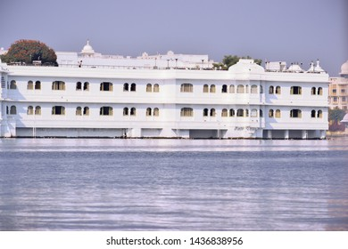 Udaipur, Rajasthan, India - 29 June 2019: Distant view of Taj Lake Palace on Lake Pichola shot at evening in Udaipur, Rajasthan, India. Taj palace is one of the luxurious hotel in India