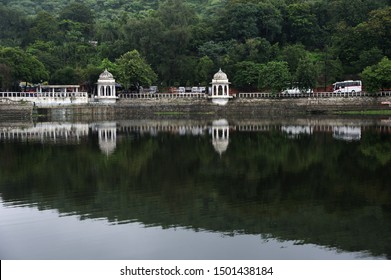 Udaipur, Rajasthan; India - Asia : Aug. 2019 :  Reflection on water monument Doodh Talai Musical Garden Udaipur