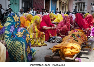 Udaipur, Rajasthan, India - August 19, 2012. Women dressed in traditional sari dresses, attend the funeral of an elderly woman, at the city of Udaipur in Rajasthan, India.