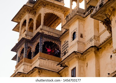 Udaipur, Rajasthan, India - circa 2017: Carved sandstone exterior walls of the udaipur palace with arches, balcony and windows. The majestic city palace is a museum that is a must visit for tourists