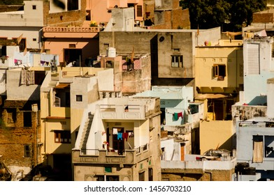 Udaipur, Rajasthan, India - circa 2017: Small haphazard houses built with terraces and balconies in the crowded city of Udiapur india. These small concrete houses are often built as real estate