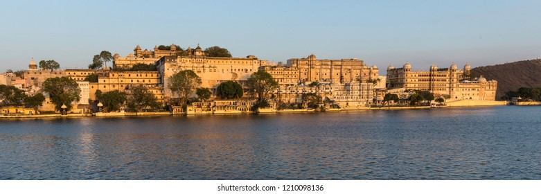 Udaipur, Rajasthan, India - Feb 24 2014 : Panoramic view of Udaipur City Palace from Lake Pichola. Built over a period of nearly 400 years, with contributions from several rulers of the Mewar dynasty