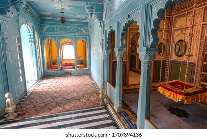 Udaipur, Rajasthan, India, January 13,2020: Udaipur City Palace medieval royal room interior architecture with wall art at Rajasthan India