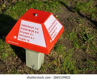 Udenhout, The Netherlands -October 31 2020 :Dutch bicycle waymark. Signpost ANWB.  Direction Udenhout, Oisterwijk, Drunen, Loon op Zand, Helvoirt, Vught, Kaatsheuvel, Waalwijk, Tilburg. Brabant serie.